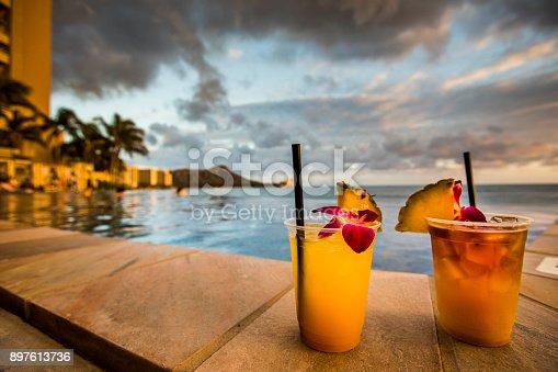 Hawaiian cocktails on Waikiki beach during sunset.