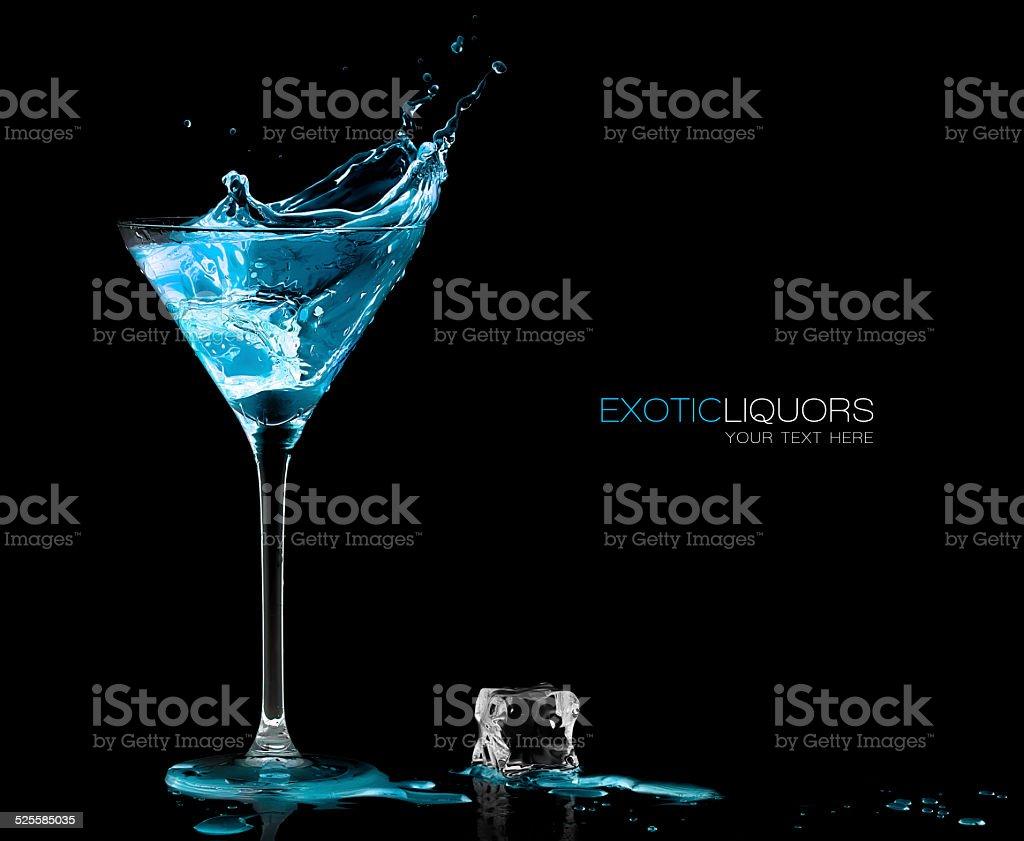 Cocktail Glass with Blue Spirit Drink Splashing. Template Design stock photo