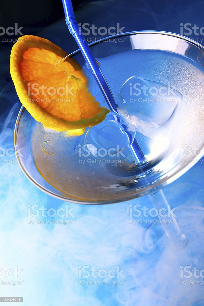 Cocktail glass with orange slice royalty-free stock photo