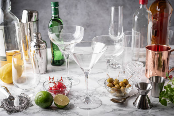 cocktail glasses and utensils on marble table stock photo
