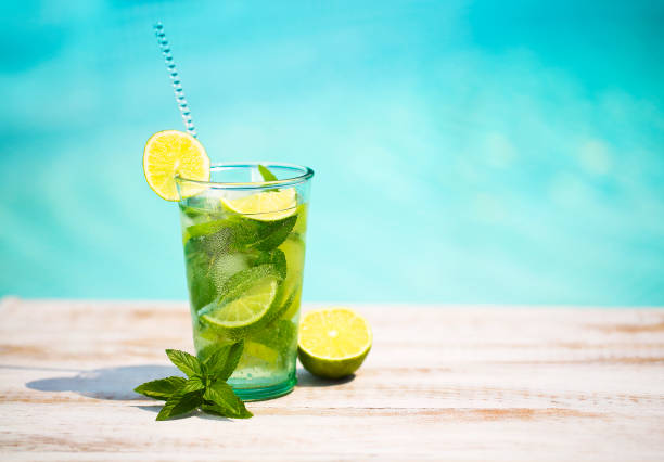 Cocktail glasses at pool, beach side. Mojito Cocktail glasses at pool, beach side. Mojito mojito stock pictures, royalty-free photos & images