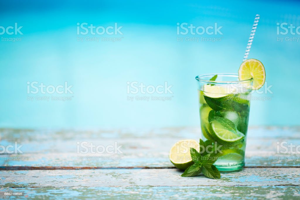 Cocktail glasses at pool, beach side. Mojito stock photo