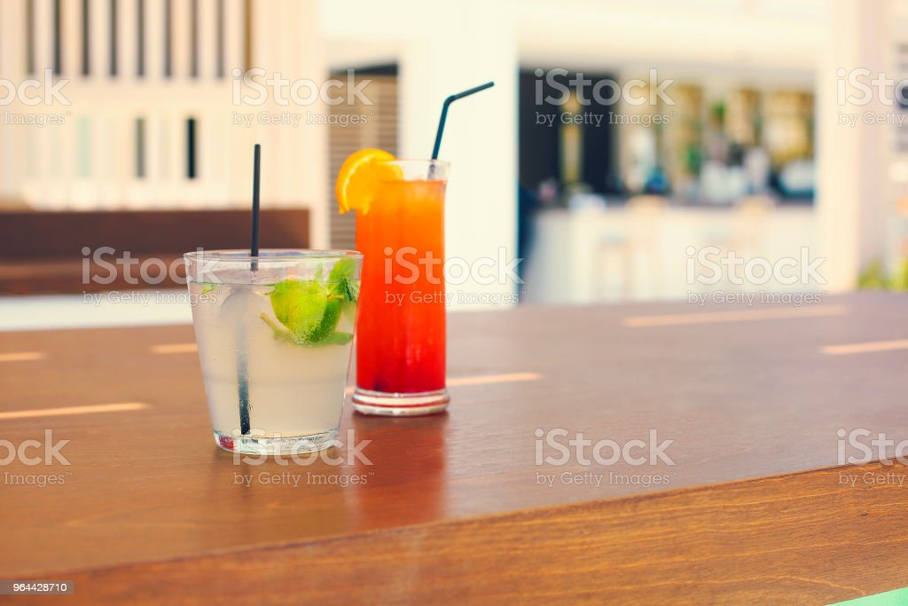 Cocktail glasses on outdoor bar counter - Royalty-free Alcohol Stock Photo