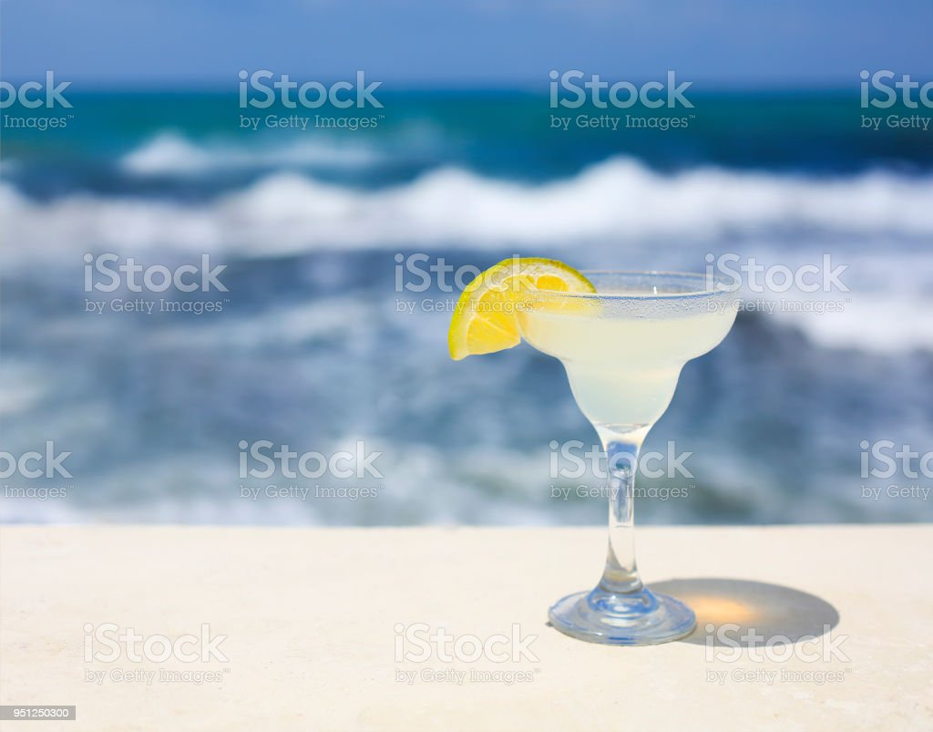 Cocktail glasses on sea background stock photo