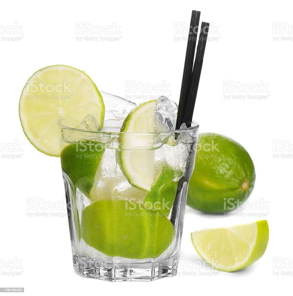 Cocktail in a glass with lime, ice and two straws stock photo