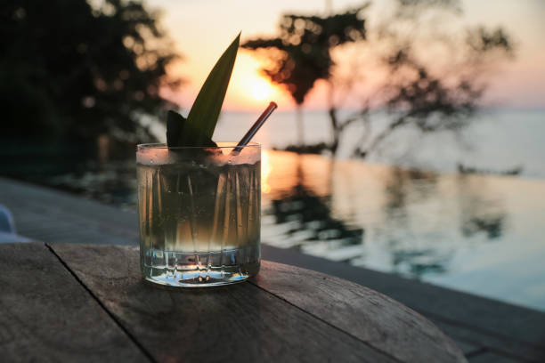 cocktail in the sunset by the pool