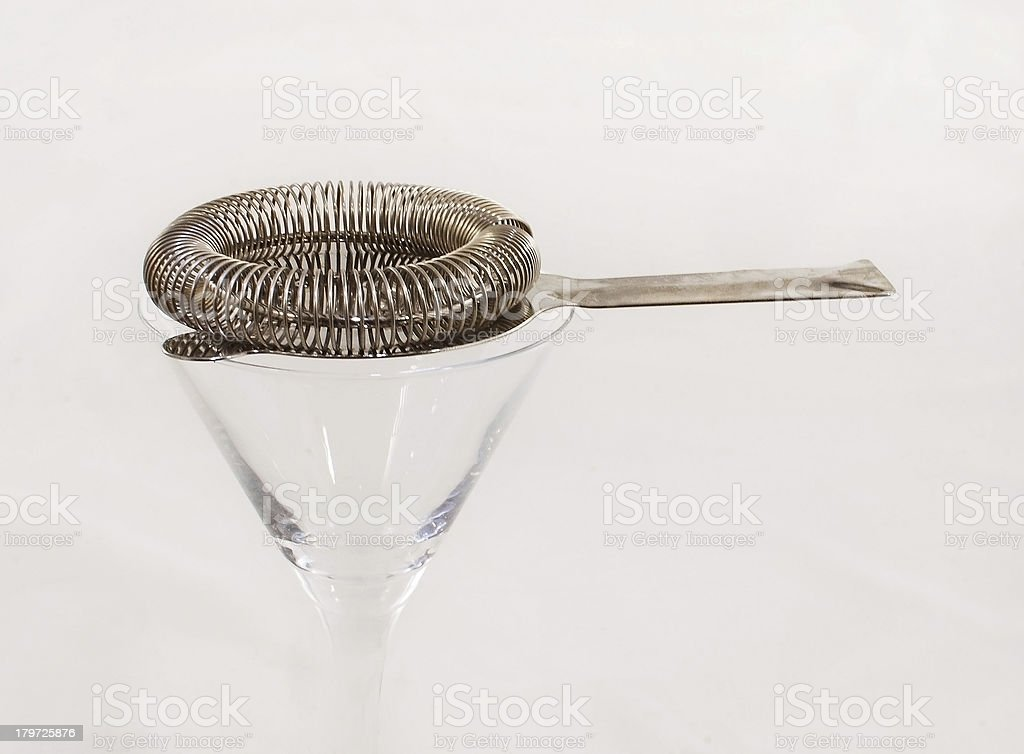 Cocktail instrument and a cup royalty-free stock photo