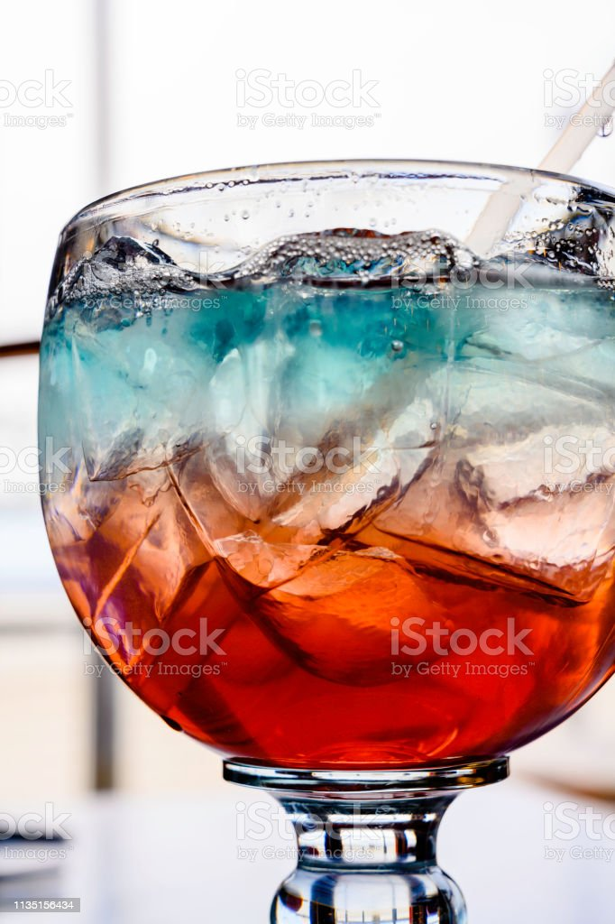 Refreshing your weekend by mixed cocktails sweet with ice in clear...