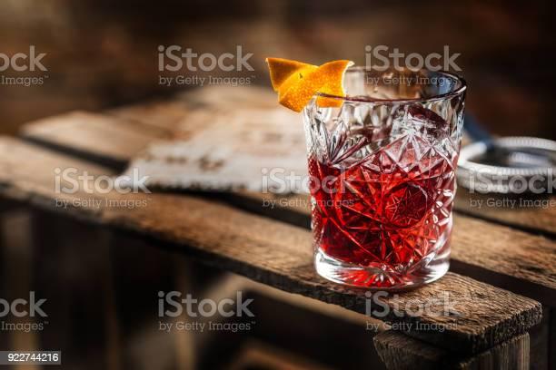 Cocktail negroni on a old wooden board drink with gin campari martini picture id922744216?b=1&k=6&m=922744216&s=612x612&h=slf6u71luhyzxjdxi4stmi ljactky76jcah4v3nr0m=