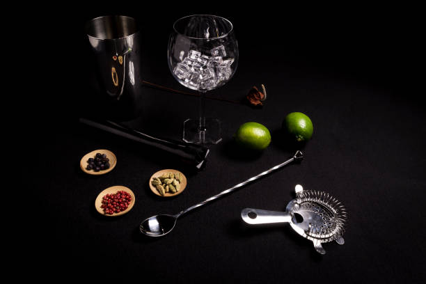 cocktail of gin and tonic on a black background with his ingreedientes stock photo