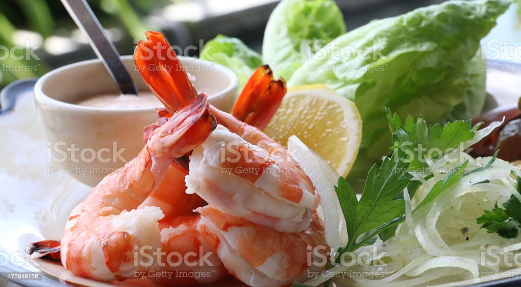 Cocktail of prawns with remoulade and romaine stock photo