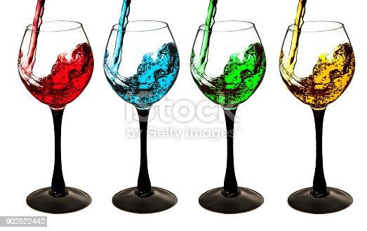 A cocktail of splash is poured into the glass, set isolated on white background