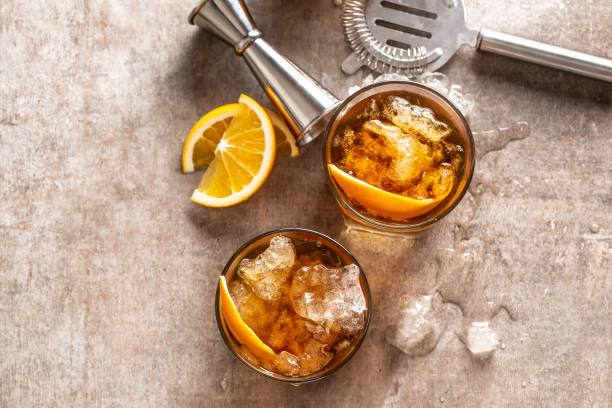 Cocktail Old fashioned Negroni with orange on the bar counter stock photo