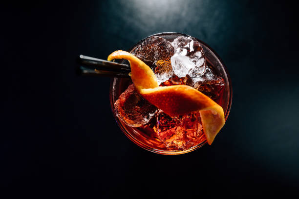 cocktail on a black background cocktail on a black background, isolated bartender stock pictures, royalty-free photos & images