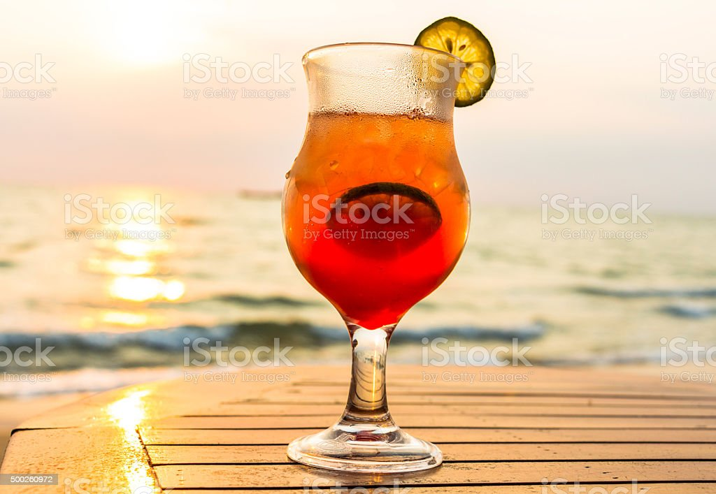 Cocktail on the beach at sunset stock photo