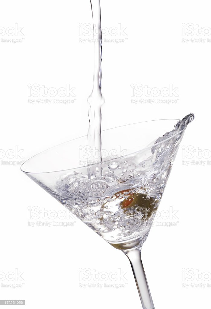 Cocktail Pouring into a Glass with an Olive royalty-free stock photo