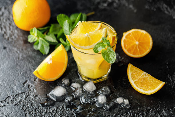 Cocktail screwdriver. Homemade orange cocktail with mint and vodka. Rum with orange juice Cocktail screwdriver. Homemade orange cocktail with mint and vodka. Rum with orange juice screwdriver drink stock pictures, royalty-free photos & images
