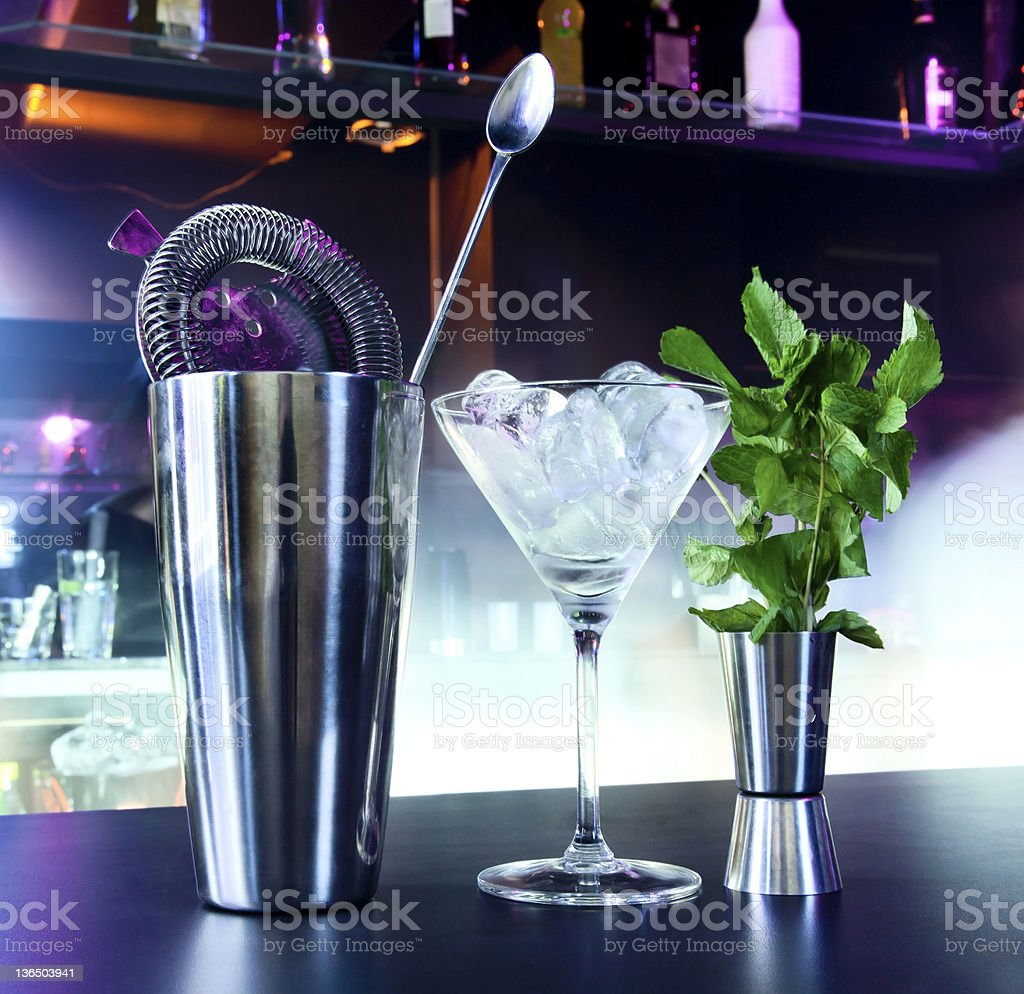 Cocktail shaker and martini glass on bar royalty-free stock photo