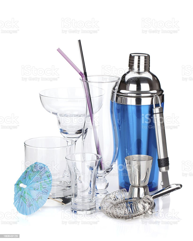 Cocktail shaker and various glasses royalty-free stock photo