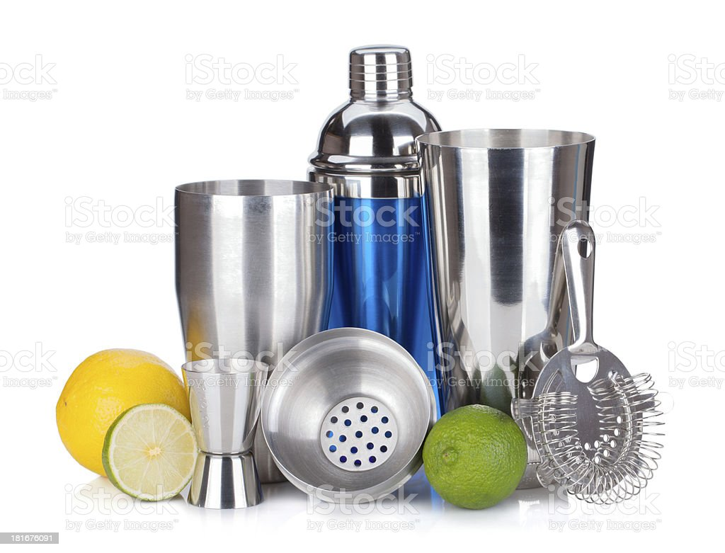 Cocktail shaker, strainer, measuring cup, drinking straws and citruses royalty-free stock photo