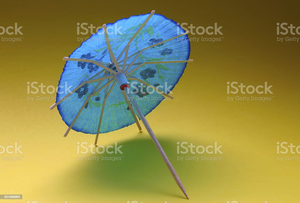 cocktail umbrella - blue #2 royalty-free stock photo