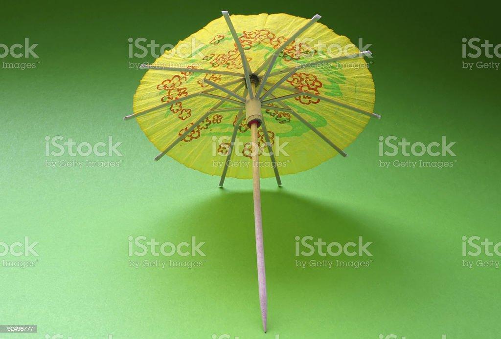 cocktail umbrella - yellow #3 royalty-free stock photo