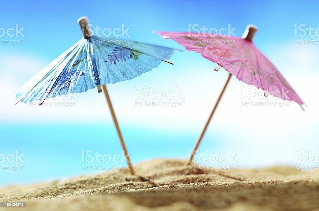 Cocktail umbrellas on the beach stock photo