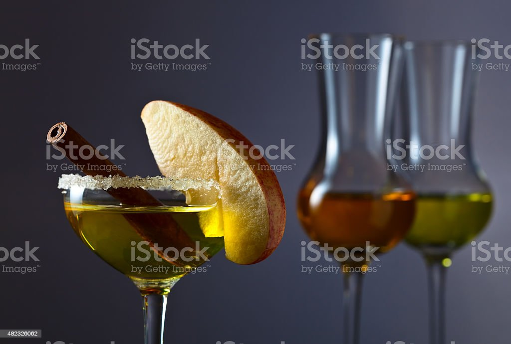 cocktail with apple and cinnamon stock photo