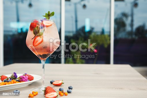 istock Cocktail with champagne against blue background 896217904
