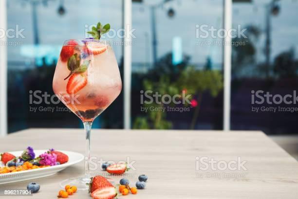 Cocktail with champagne against blue background picture id896217904?b=1&k=6&m=896217904&s=612x612&h=sqdc1drxwxal7 vuw8hrjhi2tuqctjopfhwdq5sw6q0=