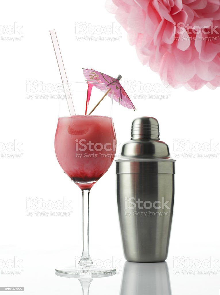 Cocktail with drink umbrella and shaker royalty-free stock photo