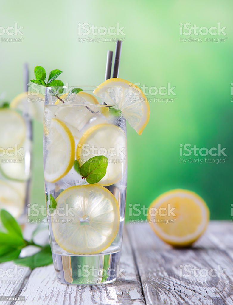 Cocktail with ice and lemon slice royalty-free stock photo