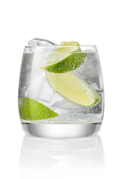 Cocktail with ice and lime Cocktail with soda water, vodka or rum, ice and lime slice isolated on white background vodka stock pictures, royalty-free photos & images