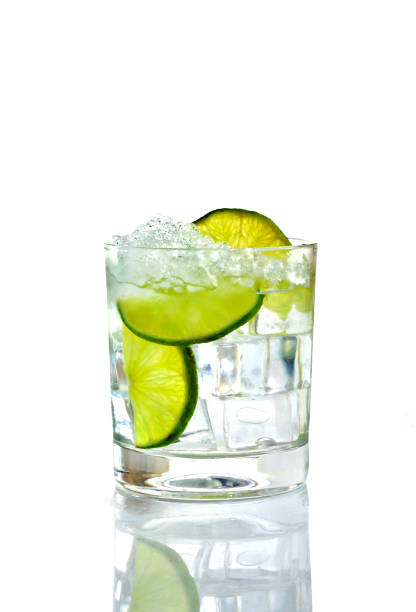 cocktail with ice and lime Cocktail with lime and crushed ice in a glass on a white background tonic water stock pictures, royalty-free photos & images