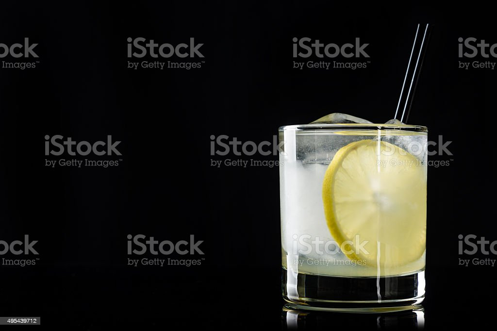 Cocktail with lemon and ice stock photo