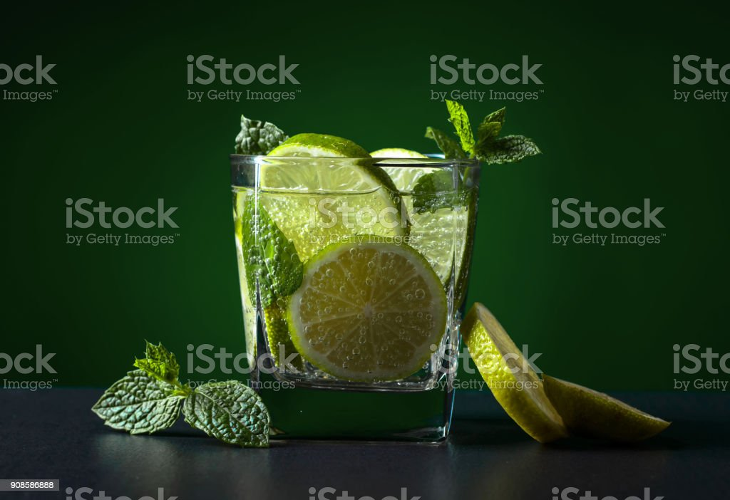 Cocktail with lime , ice  and mint . stock photo