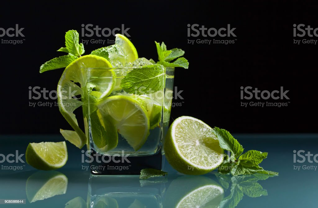 Cocktail with lime, ice and peppermint . stock photo