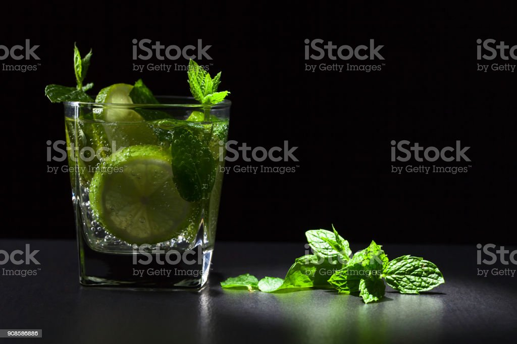 Cocktail with lime , ice  and peppermint . stock photo