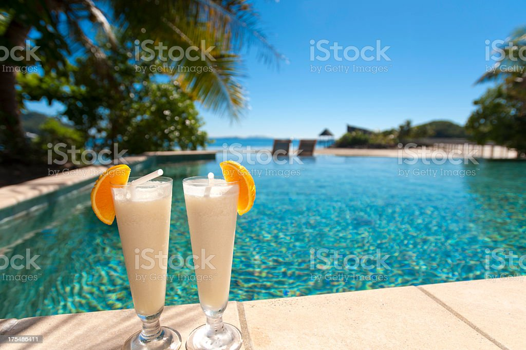 2 cocktails beside a resort swimming pool royalty-free stock photo