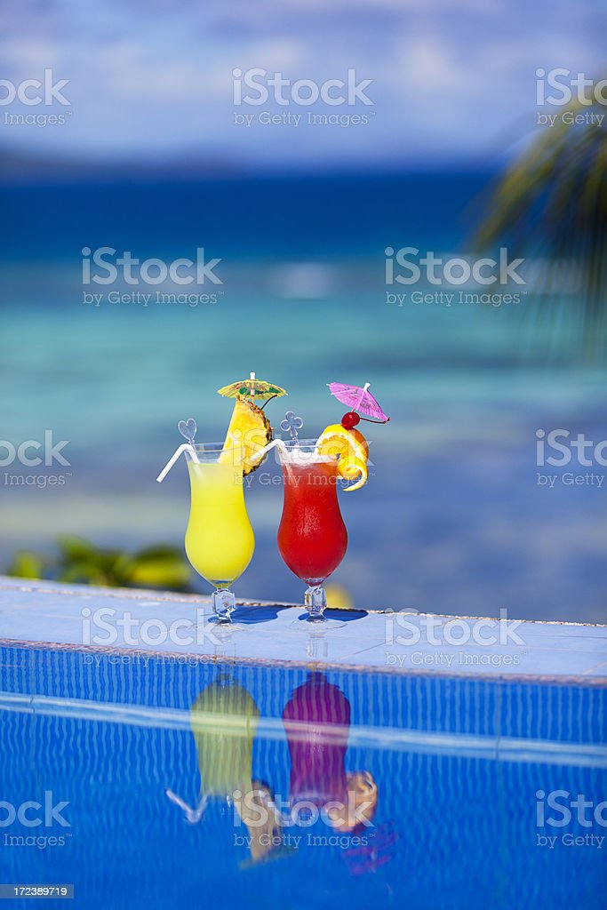 cocktails by the poolside royalty-free stock photo