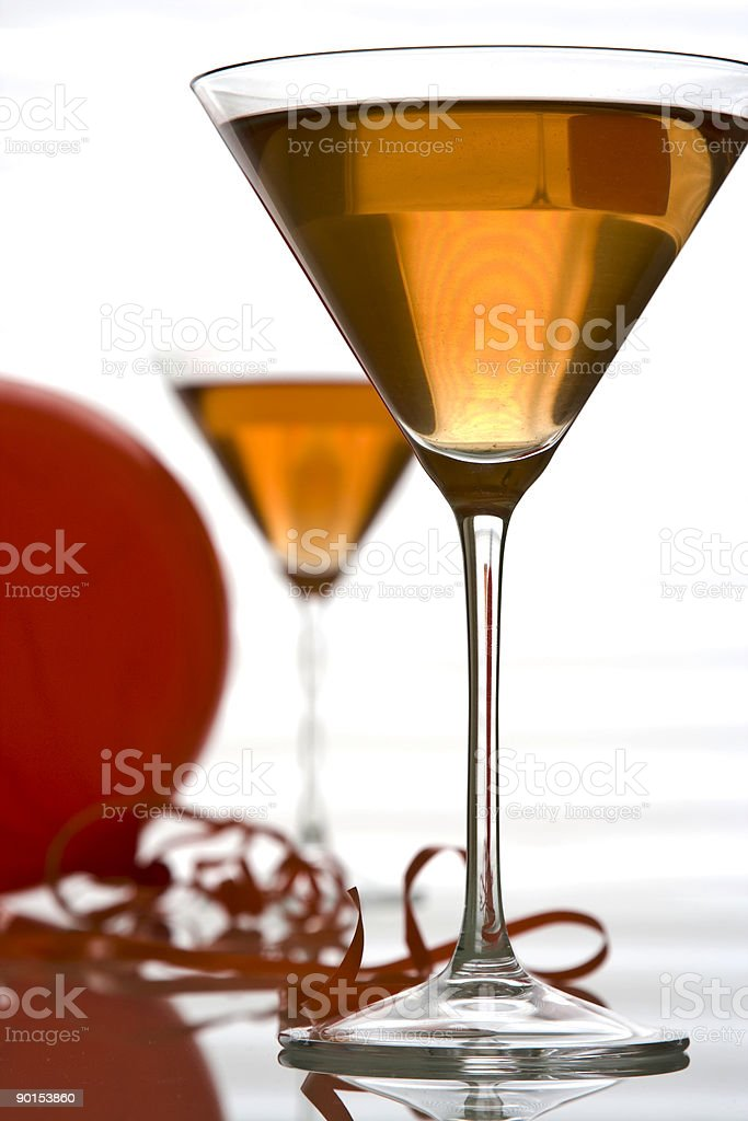 Cocktails in Martini Glasses and Red Balloon on White Background royalty-free stock photo