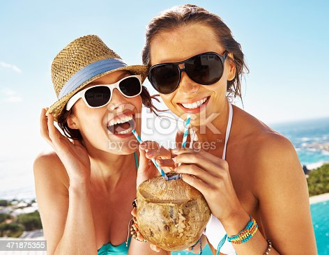 Two friends sipping on a pineapple cocktail while enjoying the summer sun by the poolhttp://195.154.178.81/DATA/i_collage/pu/shoots/784394.jpg