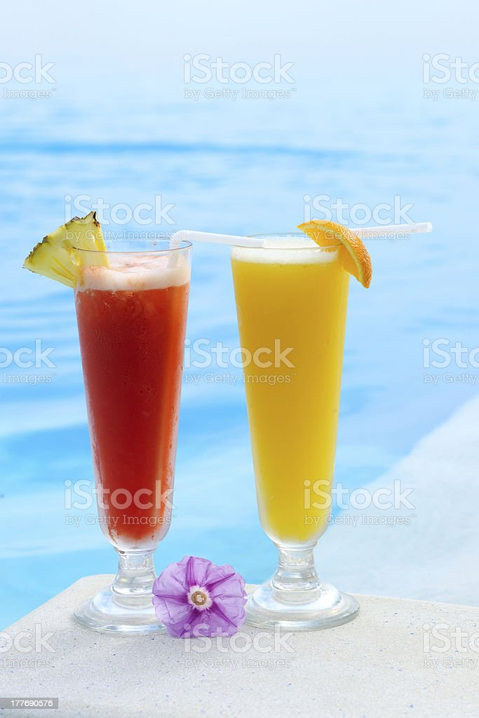 Cocktails near swimming pool royalty-free stock photo
