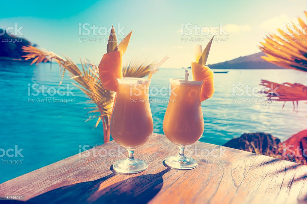 Cocktails on a table with ocean background stock photo