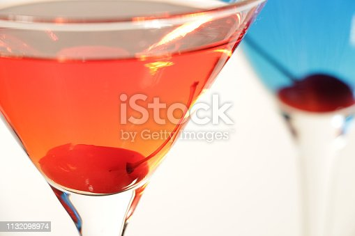 Close up shot of colorful Martini cocktails against the white background.