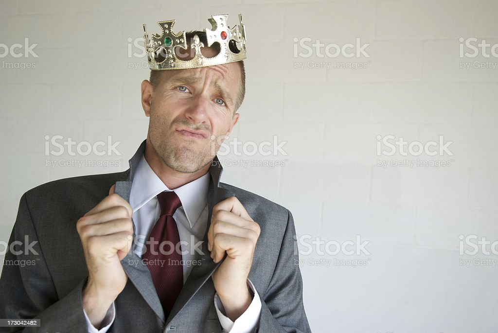Cocky Businessman King Popping His Royal Collar stock photo