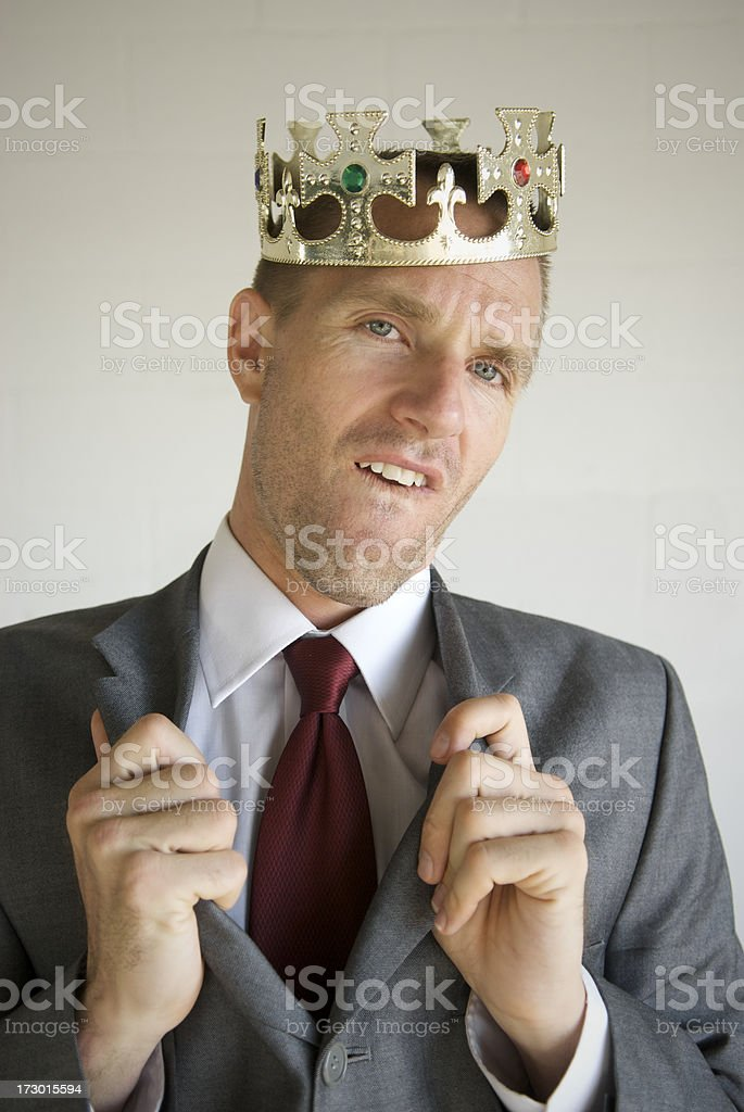 Cocky Businessman Wearing Crown Popping Collar with Attitude stock photo