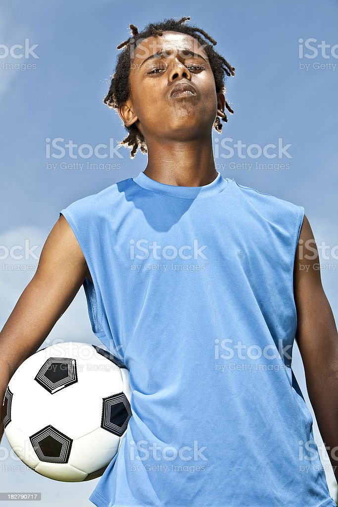 Cocky soccer player stock photo