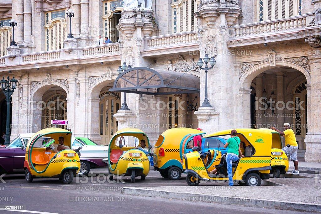 Coco taxis in front of Gran theatro de la Havana stock photo