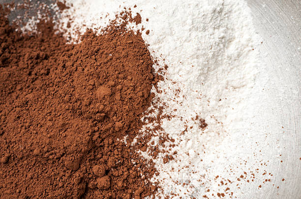 cocoa and milk ground in a bowl stock photo